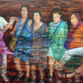 Dancing in the Streets is a painting of women in a row dancing outside at night